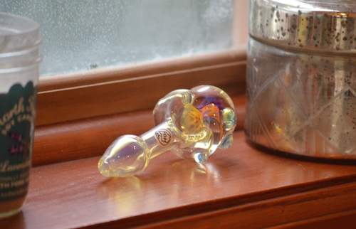 chameleon-glass-spoon-pipe-on-window-sill
