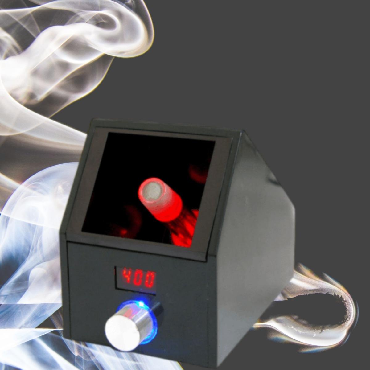 Black desktop vaporizer with smoke in the background