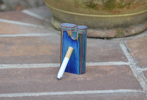 one-hitter-dugout-pipe-on-stoop